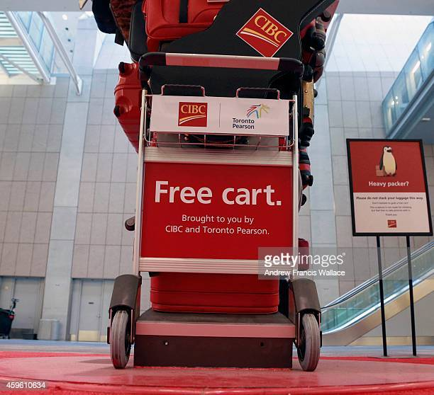 CIBC cart sculpture at the luggage carousel at Pearson International Airport November 25 2014 The bank is going after business from the 40000 people...