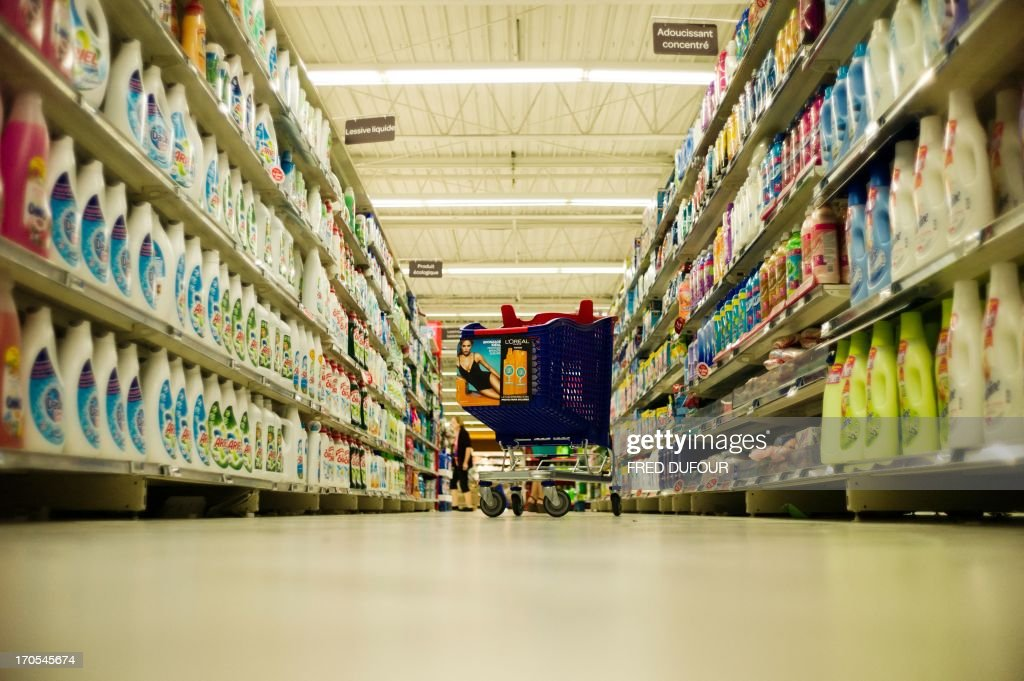 A cart shopping is seen in a rack of a Carrefour supermarket, on June 14, 2013 in Sainte-Geneviève-des-Bois, outside Paris. Installed in Sainte-Geneviève-des-Bois since fifty years, on June 15, 1963, this supermarket is the first of French giant retailer Carrefour group, but also the first in France. AFP PHOTO / FRED DUFOUR
