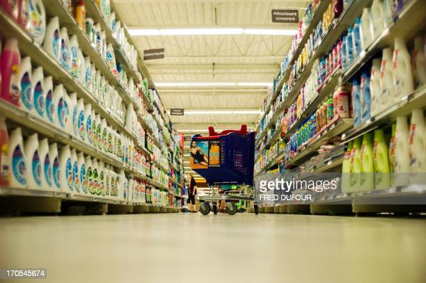 A cart shopping is seen in a rack of a Carrefour supermarket on June 14 2013 in SainteGenevièvedesBois outside Paris Installed in...