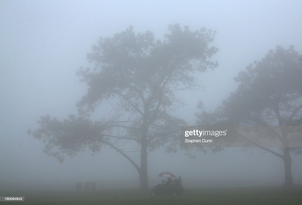 A cart sits on the course during a fog delay before the start of the third round of the Farmers Insurance Open on the South Course at Torrey Pines Golf Course on January 26, 2013 in La Jolla, California.