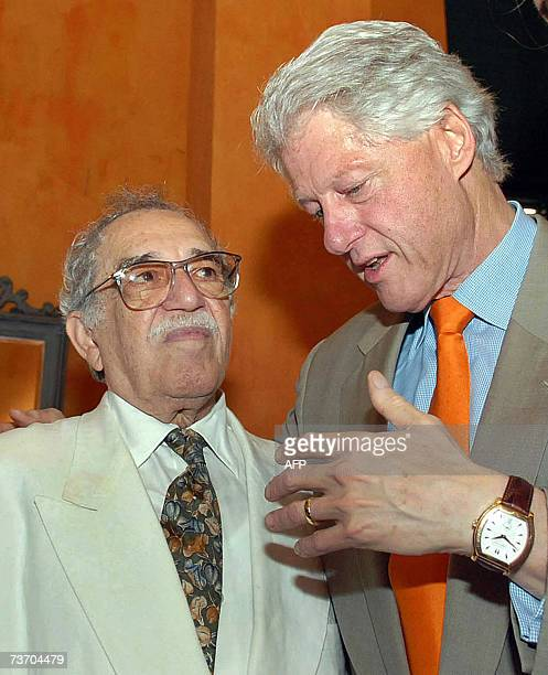 Former US President Bill Clinton speaks with Colombian writer and 1982 Literature Nobel Prize laureate Gabriel Garcia Marquez during the IV...