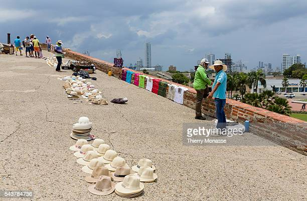 Cartagena de Indias Republic of Colombia August 22 2015 Street vendors are saleing hats to tourists in the San Felipe Barajas Castle