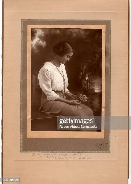 Carte de visite shows an unidentified young woman in profile as she holds a small bouquet of flowers in her lap 1914 The inscription reads 'To my own...