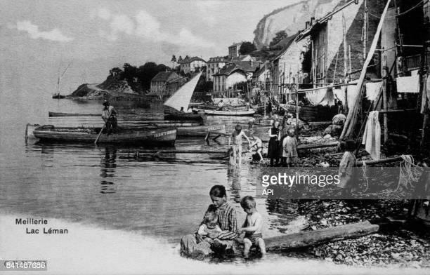 Carte postale illustrée d'une photographie de pêcheurs et leur famille au bord du lac Léman à Meillerie en France
