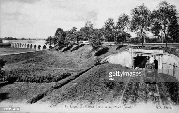 Carte postale illustrée par la photographie d'un train qui roule sur la ligne de chemin de fer BordeauxCette à Agen près du Pont Canal en France