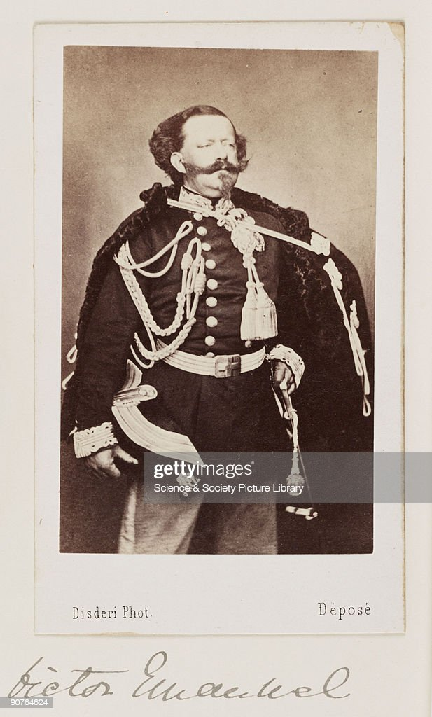 A carte-de-visite portrait of King Victor Emmanuel II, King of Sardinia, taken at the studio of Andre-Adolphe-Eugene Disdéri (1819-1889) in about 1865. Victor Emmanuel became the first king of a united Italy, following the risorgimento. A carte-de-visite is a photograph mounted on a piece of card the size of a formal visiting card of the 1850s - hence the name. The format was introduced by the French photographer Andre-Adolphe-Eugene Disderi in 1854. As well as family portraits, commercial cartes of celebrities such as politicians, royalty and popular personalities were published. The craze for collecting celebrity cartes-de-visite in albums reached its peak during the 1860s but the format remained popular until the beginning of the twentieth century. The backs of cartes-de-visite were normally printed with the photographer's name and address.