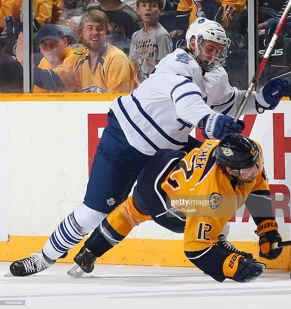 <a gi-track='captionPersonalityLinkClicked' href=/galleries/search?phrase=Carter+Ashton&family=editorial&specificpeople=4779660 ng-click='$event.stopPropagation()'>Carter Ashton</a> #37 of the Toronto Maple Leafs checks <a gi-track='captionPersonalityLinkClicked' href=/galleries/search?phrase=Mike+Fisher+-+Ice+Hockey+Player&family=editorial&specificpeople=204732 ng-click='$event.stopPropagation()'>Mike Fisher</a> #12 of the Nashville Predators at Bridgestone Arena on October 10, 2013 in Nashville, Tennessee.