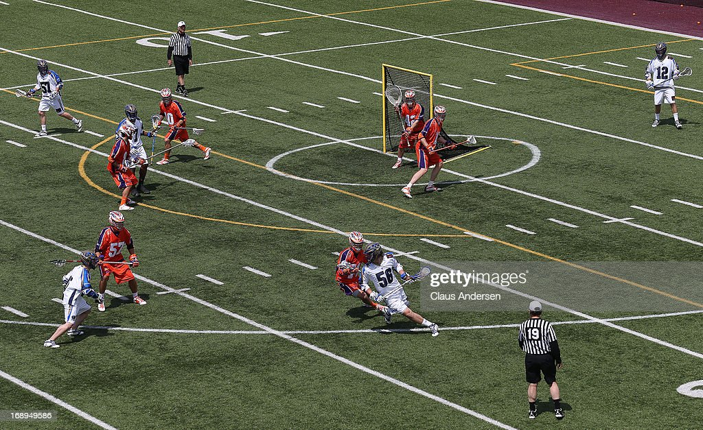 Carter Bender #56 of the Charlotte Hounds controls the ball against the Hamilton Nationals in a Major League Lacrosse game at Ron Joyce Stadium in Hamilton, Ontario, Canada. The Nationals defeated the Hounds 16-15 in overtime.