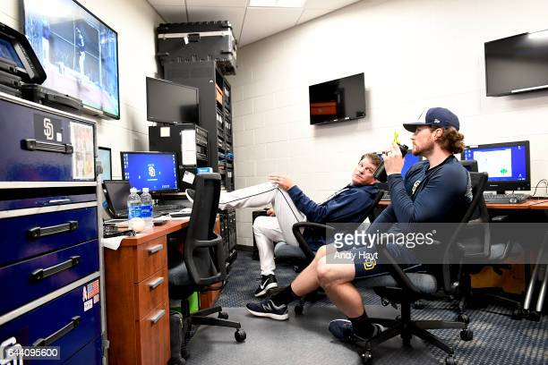 Carter Capps and Darren Balsley of the San Diego Padres watch video in the clubhouse during spring training workout at the Peoria Sports Complex on...