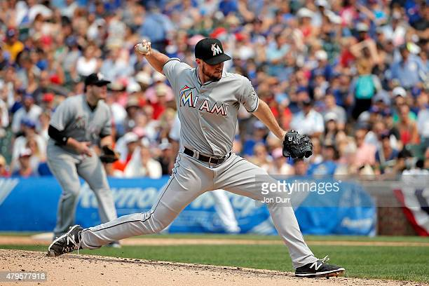 Carter Capps of the Miami Marlins pitches against the Chicago Cubs during the ninth inning at Wrigley Field on July 5 2015 in Chicago Illinois The...