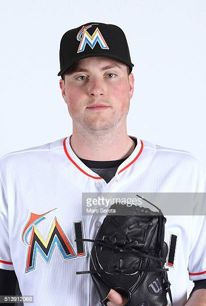 Carter Capps of the Miami Marlins poses for photos on media day at Roger Dean Stadium on February 24 2016 in Jupiter Florida