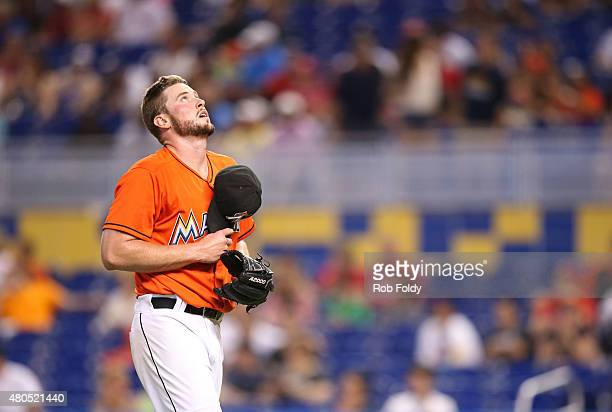 Carter Capps of the Miami Marlins reacts as he walks off the field during the game against the Cincinnati Reds at Marlins Park on July 12 2015 in...
