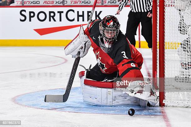 Carter Hart of Team Canada looks to cover the puck during the 2017 IIHF World Junior Championship gold medal game against Team United States at the...