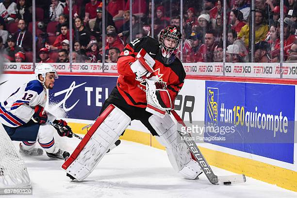 Carter Hart of Team Canada looks to play the puck during the 2017 IIHF World Junior Championship gold medal game against Team United States at the...