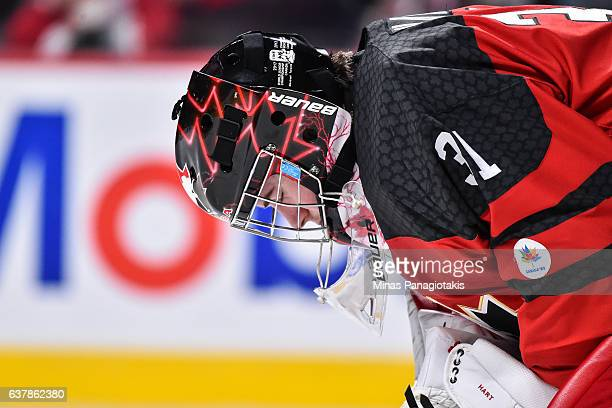 Carter Hart of Team Canada lowers his head during the 2017 IIHF World Junior Championship gold medal game against Team United States at the Bell...