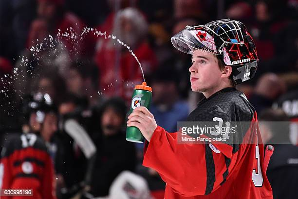Carter Hart of Team Canada sprays water during the 2017 IIHF World Junior Championship semifinal game against Team Sweden at the Bell Centre on...