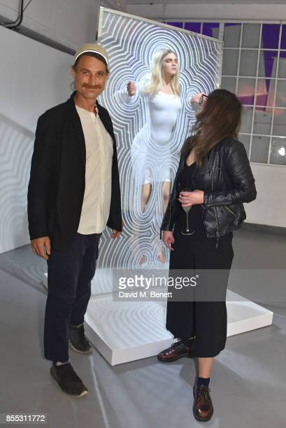 Carter Healy and guest attend a private view of artist Chemical X's new exhibition 'CX300' at The Vinyl Factory on September 28 2017 in London England