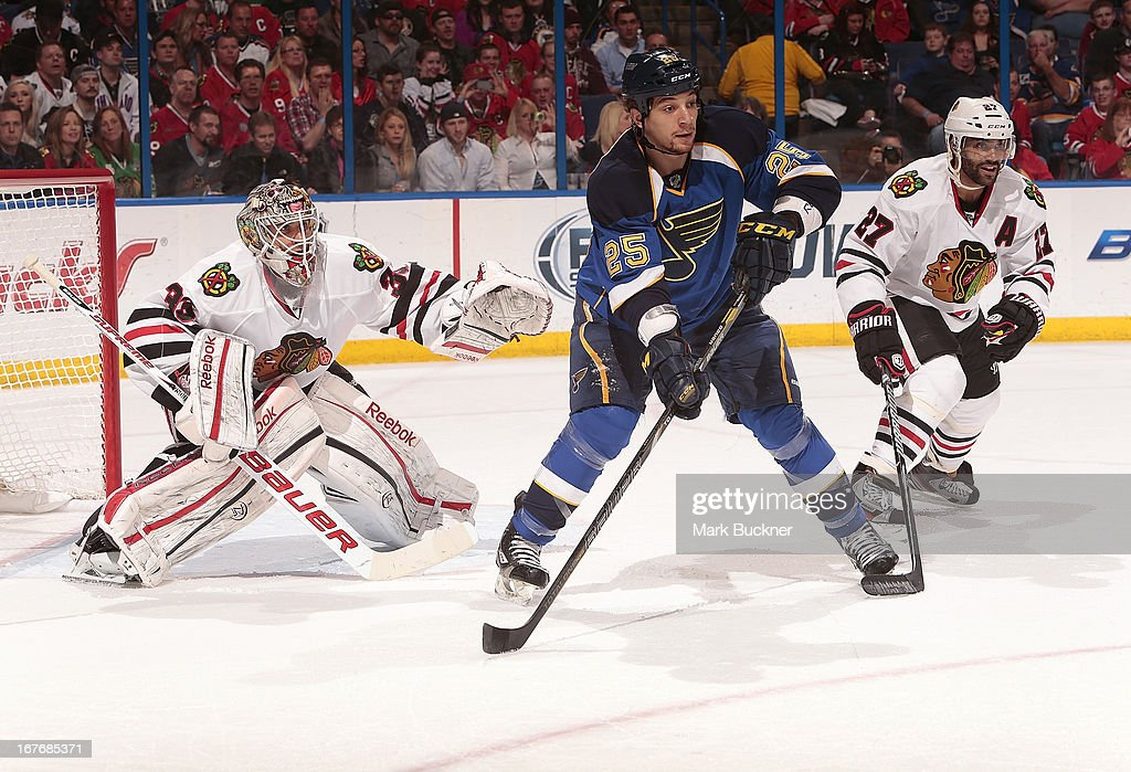 Carter Hutton #33 and Johnny Oduya #27 of the Chicago Blackhawks defend against Chris Stewart #25 of the St. Louis Blues in an NHL game on April 27, 2013 at Scottrade Center in St. Louis, Missouri.