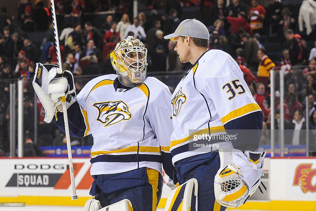 <a gi-track='captionPersonalityLinkClicked' href=/galleries/search?phrase=Carter+Hutton&family=editorial&specificpeople=6872781 ng-click='$event.stopPropagation()'>Carter Hutton</a> #30 (L) and <a gi-track='captionPersonalityLinkClicked' href=/galleries/search?phrase=Pekka+Rinne&family=editorial&specificpeople=2118342 ng-click='$event.stopPropagation()'>Pekka Rinne</a> #35 of the Nashville Predators talk after defeating the Calgary Flames at Scotiabank Saddledome on March 21, 2014 in Calgary, Alberta, Canada. The Predators defeated the Flames 6-5.