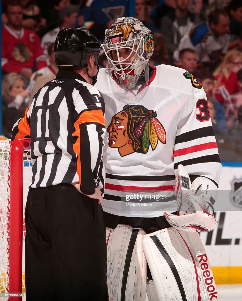 Carter Hutton #33 of the Chicago Blackhawks talks with referee Kelly Sutherland #11 in an NHL game against the St. Louis Blues on April 27, 2013 at Scottrade Center in St. Louis, Missouri.