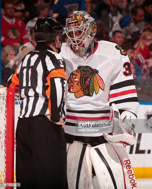 Carter Hutton of the Chicago Blackhawks talks with referee Kelly Sutherland in an NHL game against the St Louis Blues on April 27 2013 at Scottrade...