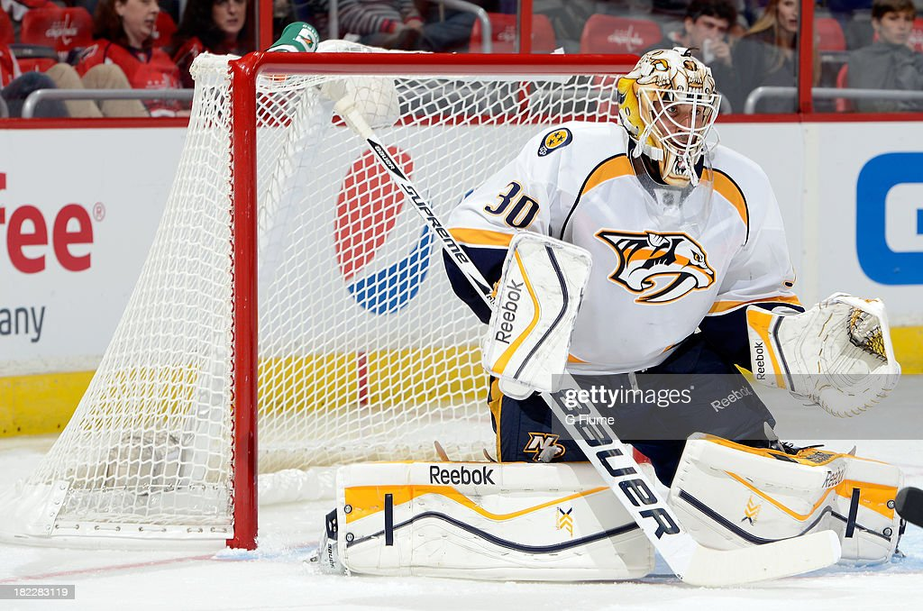 Carter Hutton #30 of the Nashville Predators defends the goal against the Washington Capitals during a preseason game at the Verizon Center on September 25, 2013 in Washington, DC.
