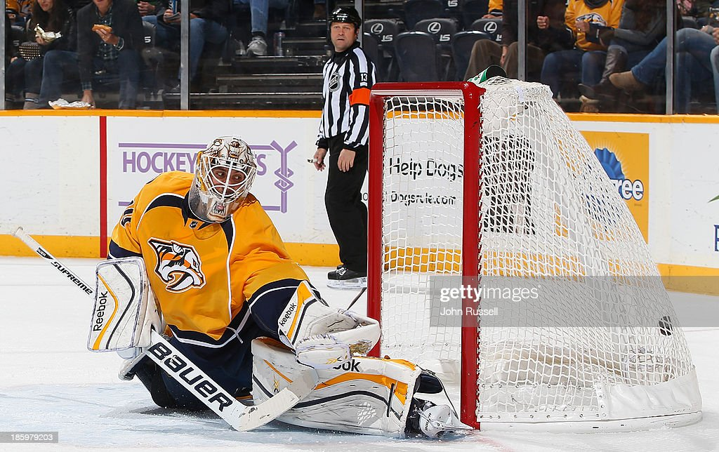 <a gi-track='captionPersonalityLinkClicked' href=/galleries/search?phrase=Carter+Hutton&family=editorial&specificpeople=6872781 ng-click='$event.stopPropagation()'>Carter Hutton</a> #30 of the Nashville Predators lets a shot by T.J. Oshie #74 of the St. Louis Blues (not pictured) in the net at Bridgestone Arena on October 26, 2013 in Nashville, Tennessee.