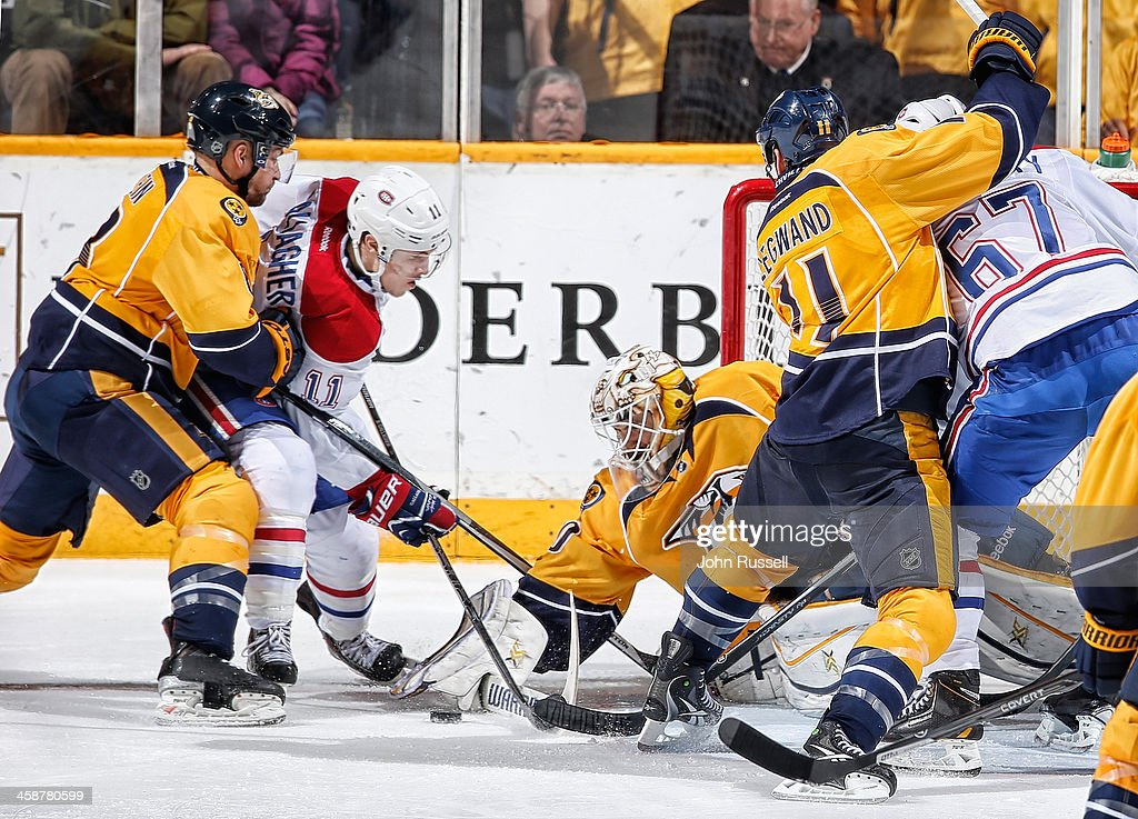 <a gi-track='captionPersonalityLinkClicked' href=/galleries/search?phrase=Carter+Hutton&family=editorial&specificpeople=6872781 ng-click='$event.stopPropagation()'>Carter Hutton</a> #30 of the Nashville Predators makes the save against <a gi-track='captionPersonalityLinkClicked' href=/galleries/search?phrase=Brendan+Gallagher&family=editorial&specificpeople=3704208 ng-click='$event.stopPropagation()'>Brendan Gallagher</a> #11 of the Montreal Canadiens as Predators Kevin Klein #8 defends at Bridgestone Arena on December 21, 2013 in Nashville, Tennessee.