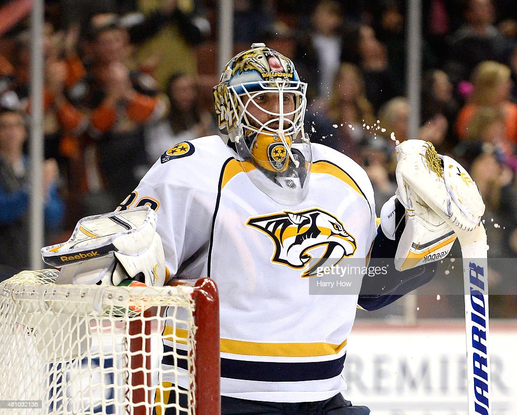 Carter Hutton #30 of the Nashville Predators reacts after a goal from Francois Beauchemin #23 of the Anaheim Ducks to tie the game 3-3 during the third period at Honda Center on January 4, 2015 in Anaheim, California.