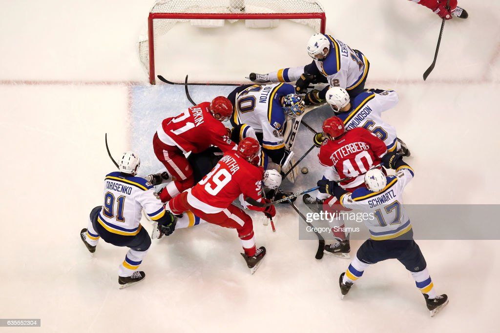 Carter Hutton #40 of the St. Louis Blues tries to keep his eye on the puck while playing the Detroit Red Wings at Joe Louis Arena on February 15, 2017 in Detroit, Michigan. St. Louis won the game 2-0.