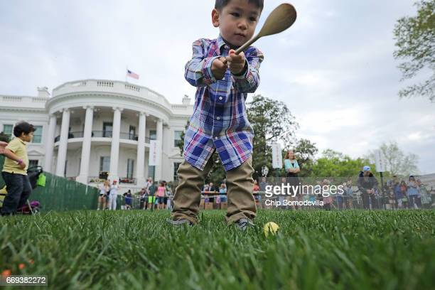 Carter of Vienna VA rolls a colored egg down the White House South Lawn during the 139th Easter Egg Roll April 17 2017 in Washington DC The White...