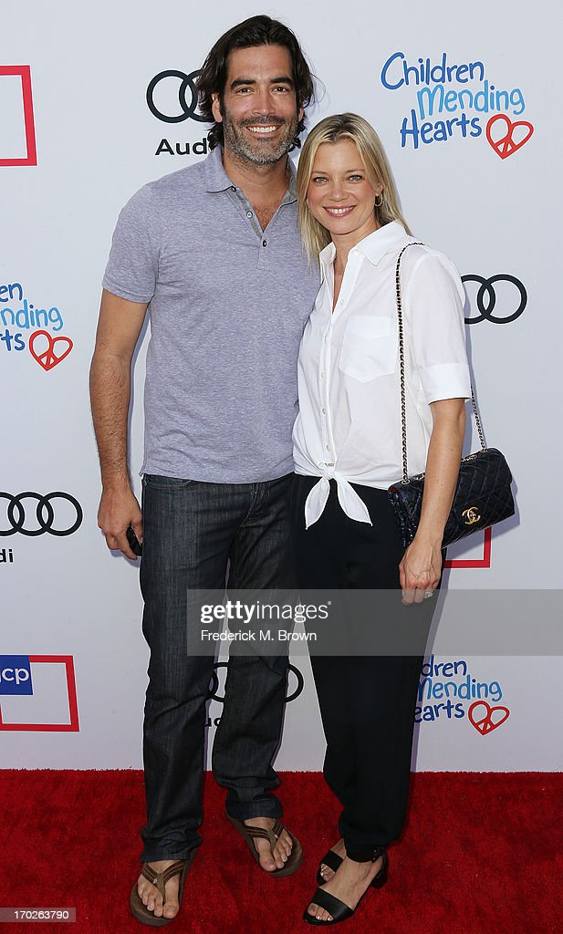 Carter Oosterhouse (L) and actress Amy Smart attend the First Annual Children Mending Hearts Style Sunday on June 9, 2013 in Beverly Hills, California.