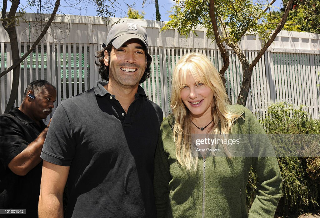 Carter Oosterhouse and Daryl Hannah attend the Environmental Media Association and Yes to Carrots Garden Luncheon at The Learning Garden at Venice High School on May 26, 2010 in Venice, California.