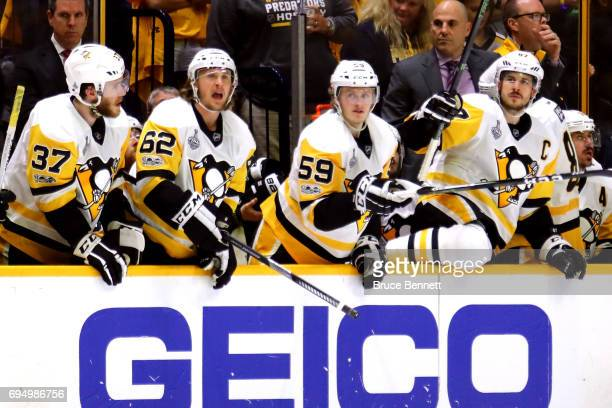 Carter Rowney Carl Hagelin Jake Guentzel and Sidney Crosby of the Pittsburgh Penguins look on against the Nashville Predators during the second...