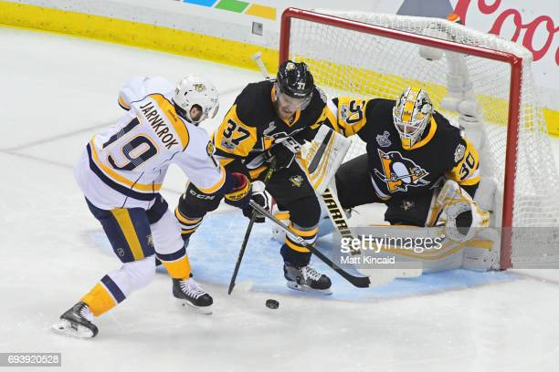 Carter Rowney defends as Matt Murray of the Pittsburgh Penguins tends to net against Calle Jarnkrok of the Nashville Predators during the first...