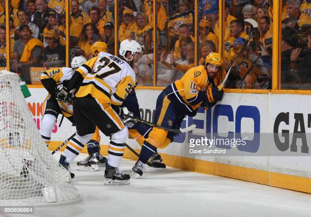 Carter Rowney of the Pittsburgh Penguins and James Neal of the Nashville Predators vie for position behind the net in Game Six of the 2017 NHL...
