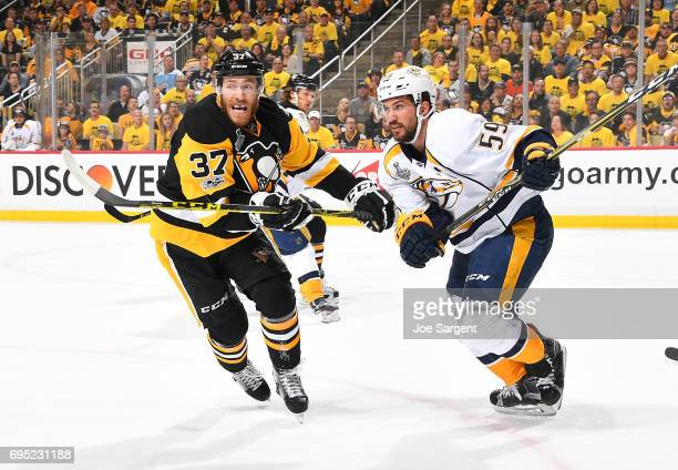 Carter Rowney of the Pittsburgh Penguins and Roman Josi of the Nashville Predators battle for position in Game Five of the 2017 NHL Stanley Cup Final...