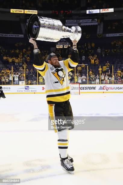 Carter Rowney of the Pittsburgh Penguins celebrates with the Stanley Cup trophy after defeating the Nashville Predators 20 in Game Six of the 2017...