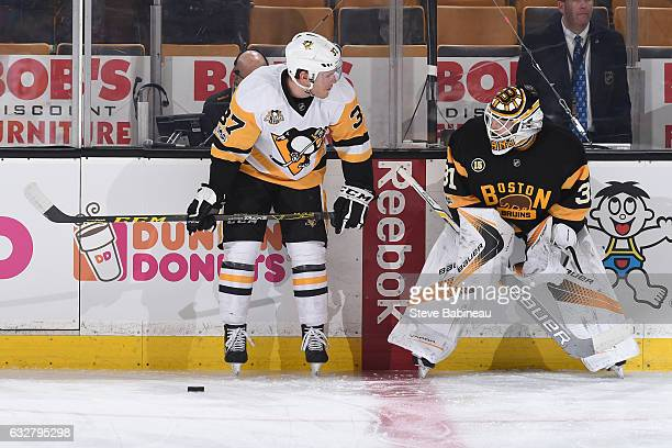Carter Rowney of the Pittsburgh Penguins chats before the game with Zane McIntyre of the Boston Bruins at the TD Garden on January 26 2017 in Boston...