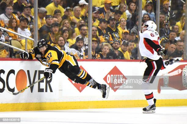 Carter Rowney of the Pittsburgh Penguins falls to the ice against Mark Stone of the Ottawa Senators during the third period in Game Seven of the...