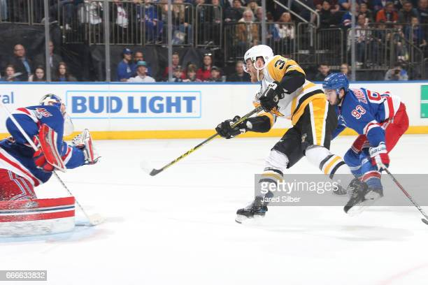 Carter Rowney of the Pittsburgh Penguins shoots and scores in the second period against Magnus Hellberg of the New York Rangers at Madison Square...