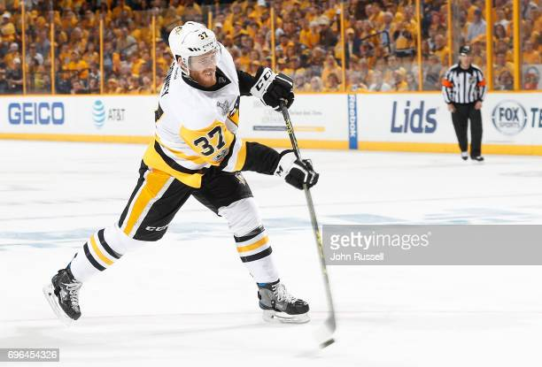 Carter Rowney of the Pittsburgh Penguins shoots the puck against the Nashville Predators during Game Three of the 2017 NHL Stanley Cup Final at...