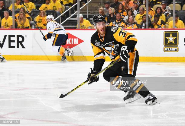 Carter Rowney of the Pittsburgh Penguins skates against the Nashville Predators in Game Five of the 2017 NHL Stanley Cup Final at PPG Paints Arena on...