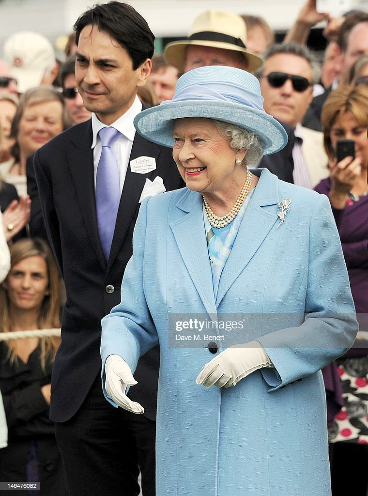 Cartier Managing Director Francois Le Troquer (L) and Queen <a gi-track='captionPersonalityLinkClicked' href=/galleries/search?phrase=Elizabeth+II&family=editorial&specificpeople=67226 ng-click='$event.stopPropagation()'>Elizabeth II</a> attend the Cartier Queen's Cup Polo Day 2012 at Guards Polo Club on June 17, 2012 in Egham, England.