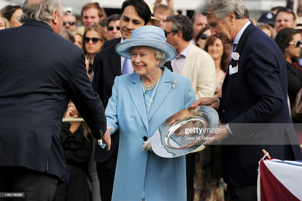 Cartier Managing Director Francois Le Troquer, Queen <a gi-track='captionPersonalityLinkClicked' href=/galleries/search?phrase=Elizabeth+II&family=editorial&specificpeople=67226 ng-click='$event.stopPropagation()'>Elizabeth II</a> and Executive Chairman of Cartier UK <a gi-track='captionPersonalityLinkClicked' href=/galleries/search?phrase=Arnaud+Bamberger&family=editorial&specificpeople=227439 ng-click='$event.stopPropagation()'>Arnaud Bamberger</a> attend the Cartier Queen's Cup Polo Day 2012 at Guards Polo Club on June 17, 2012 in Egham, England.