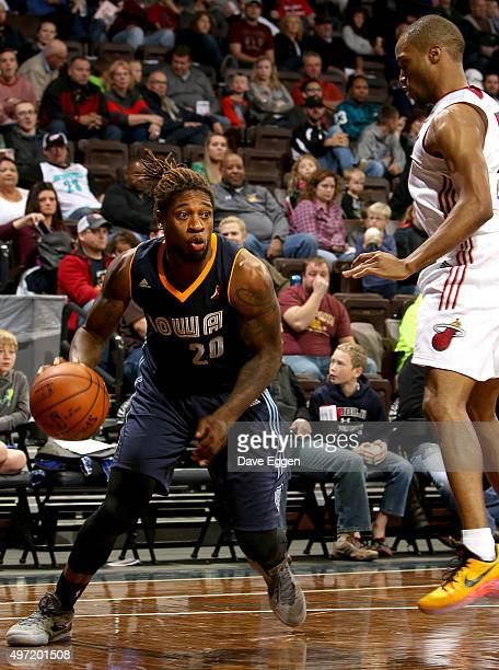 Cartier Martin from the Iowa Energy looks to drive against Tre Kelley from the Sioux Falls Skyforce in the first half of their NBA DLeague game...