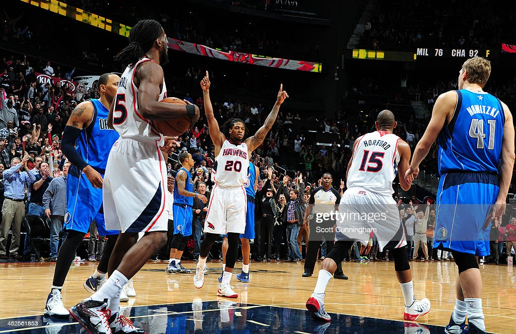 <a gi-track='captionPersonalityLinkClicked' href=/galleries/search?phrase=Cartier+Martin&family=editorial&specificpeople=834581 ng-click='$event.stopPropagation()'>Cartier Martin</a> #20 of the Atlanta Hawks celebrates after defeating the Dallas Mavericks on November 29, 2013 at Philips Arena in Atlanta, Georgia.