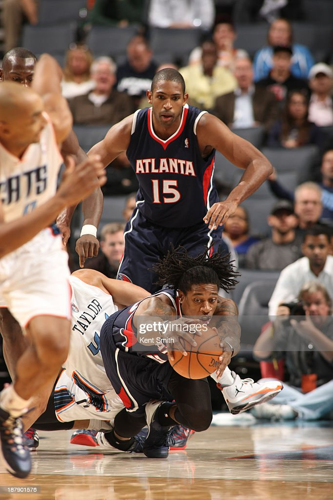 <a gi-track='captionPersonalityLinkClicked' href=/galleries/search?phrase=Cartier+Martin&family=editorial&specificpeople=834581 ng-click='$event.stopPropagation()'>Cartier Martin</a> #20 of the Atlanta Hawks dives for the ball against the Charlotte Bobcats during the game at the Time Warner Cable Arena on November 11, 2013 in Charlotte, North Carolina.