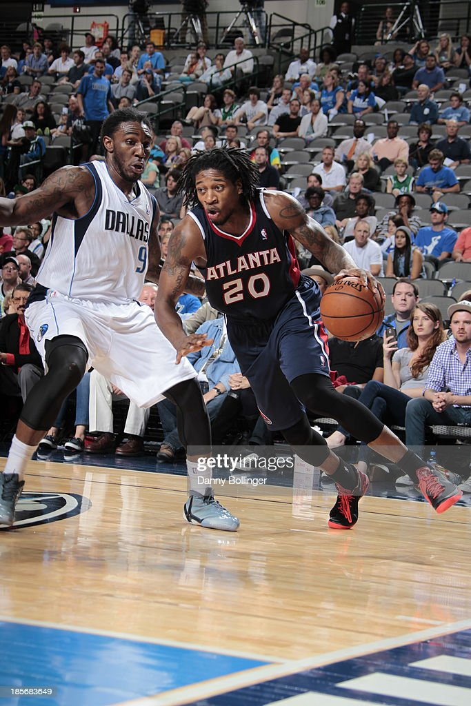 <a gi-track='captionPersonalityLinkClicked' href=/galleries/search?phrase=Cartier+Martin&family=editorial&specificpeople=834581 ng-click='$event.stopPropagation()'>Cartier Martin</a> #20 of the Atlanta Hawks drives against <a gi-track='captionPersonalityLinkClicked' href=/galleries/search?phrase=Jae+Crowder&family=editorial&specificpeople=7357507 ng-click='$event.stopPropagation()'>Jae Crowder</a> #9 of the Dallas Mavericks on October 23, 2013 at the American Airlines Center in Dallas, Texas.