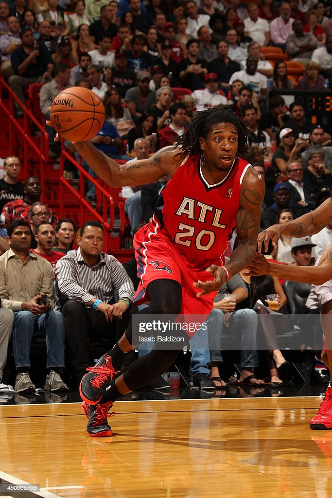 <a gi-track='captionPersonalityLinkClicked' href=/galleries/search?phrase=Cartier+Martin&family=editorial&specificpeople=834581 ng-click='$event.stopPropagation()'>Cartier Martin</a> #20 of the Atlanta Hawks drives baseline against the Miami Heat on November 19, 2013 at American Airlines Arena in Miami, Florida.